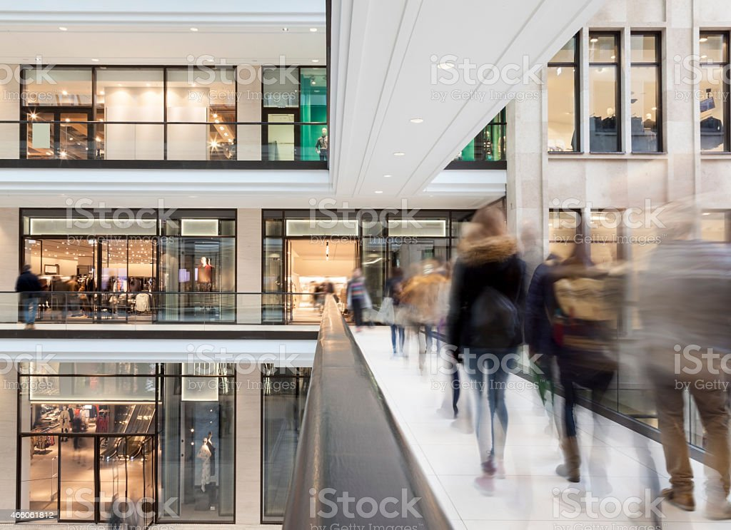 Shoppers Walking to the Mall with Stores and Shops stock photo