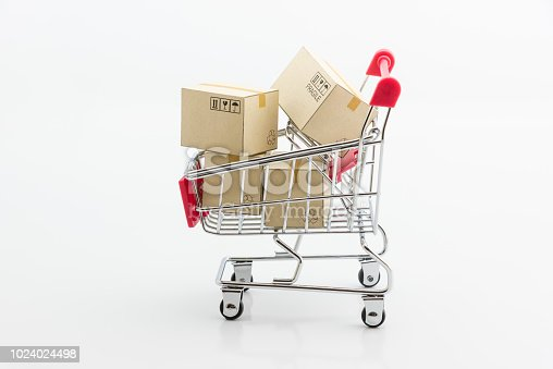 istock Shopping addiction, shopping lover or shopaholic concept : Paper boxes / cartons and small toy shopping cart, on white background. Many people / consumers or buyers addicted to buy unnecessary things. 1024024498