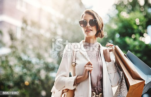 istock Shopping always makes her happy 888019382