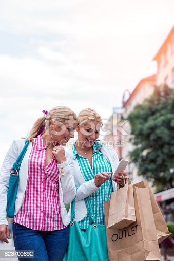 Shopping and Looking at Smart Phone