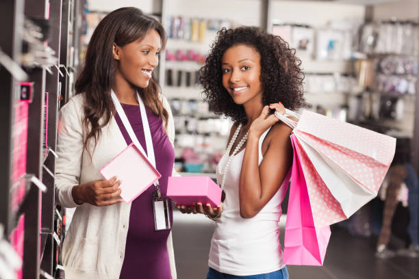 shopping at beauty store. - makeup for pregnant women stock photos and pictures