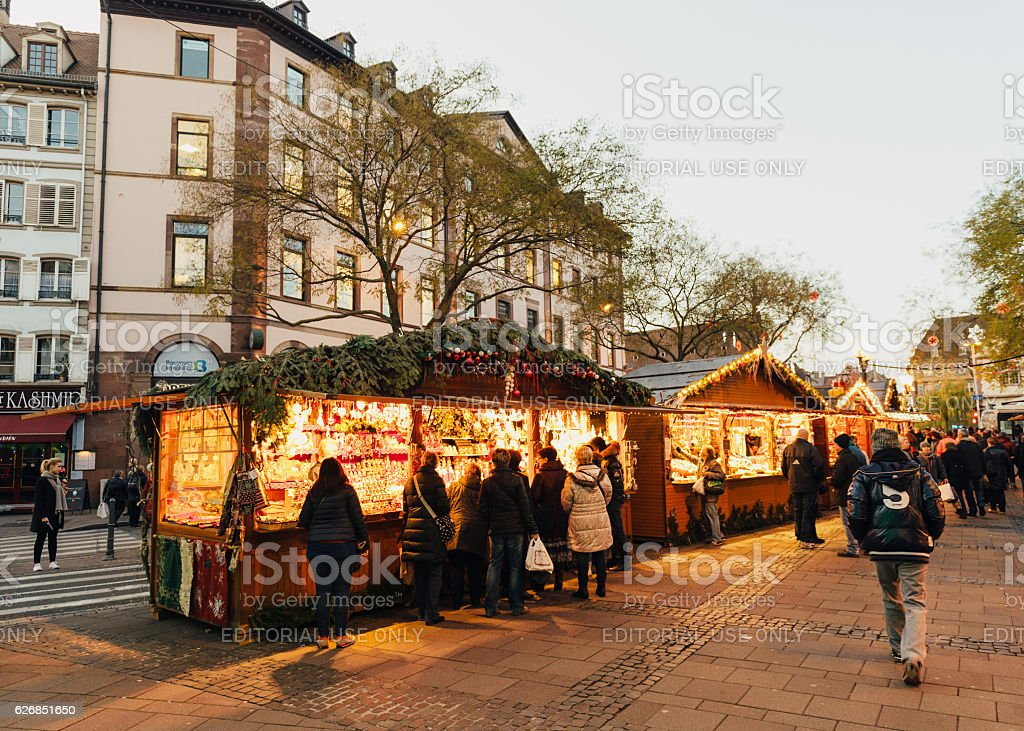Shopping at Christmas Market with people having fun stock photo