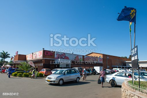 Harare, Zimbabwe - May 12, 2016: Zimbabweans shop at South African-based franchise retail outlets at a suburban shopping centre near Harare. The country recently adopted the US dollar as its currency after the inflation-driven demise of the Zim dollar, and is currently in the process of attamepting to re-adopt its own or an African currency but facing stiff resistance from its countrymen.