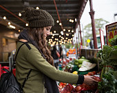 Young woman shopping for fresh produce at South Melbourne Market. Melbourne, Australia.