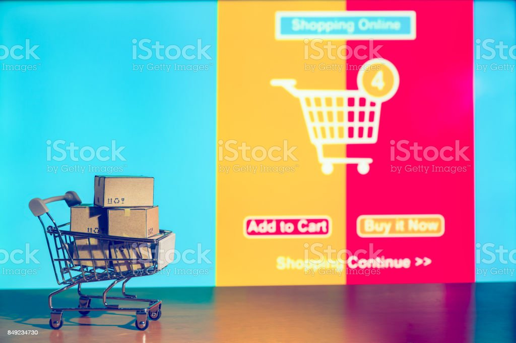 shopping background, Cartons in shopping cart with ad order shopping scene background, shopping online concept, Business about internet of thing background. stock photo