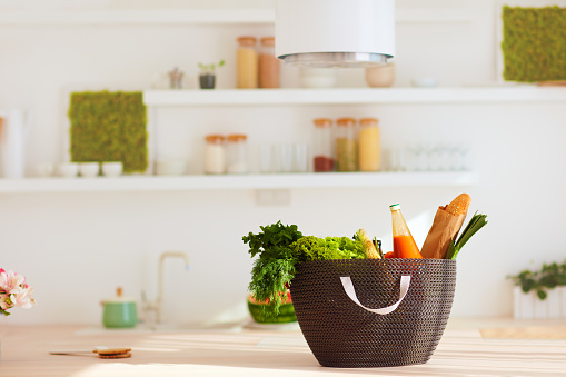 istock shopping bag full of fresh food on kitchen desk 922440260
