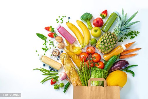 istock Shopping bag full of fresh vegetables and fruits isolated on white 1131795546