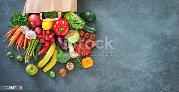 istock Shopping bag full of fresh vegetables and fruits 1128687119