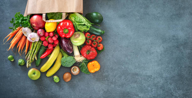 Shopping bag full of fresh vegetables and fruits Healthy food selection. Shopping bag full of fresh vegetables and fruits. Flat lay food on table fruit stock pictures, royalty-free photos & images