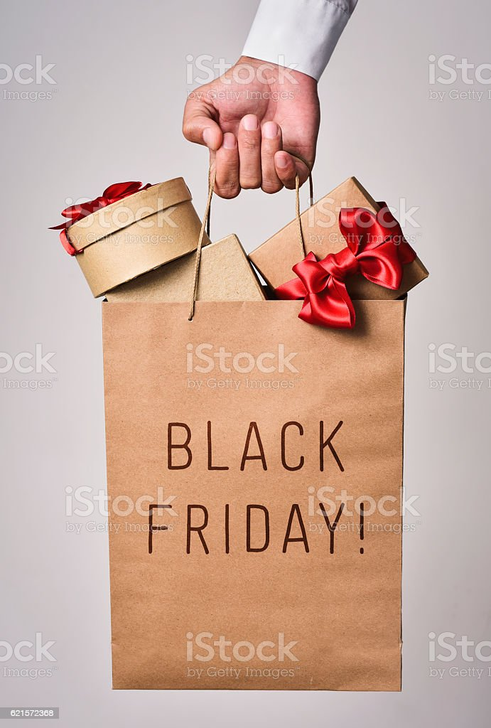 shopping bag full of gifts and text black friday photo libre de droits
