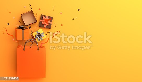 istock Shopping bag, gift box, confetti on orange background. Design creative concept of happy halloween celebration holiday. 1171139936