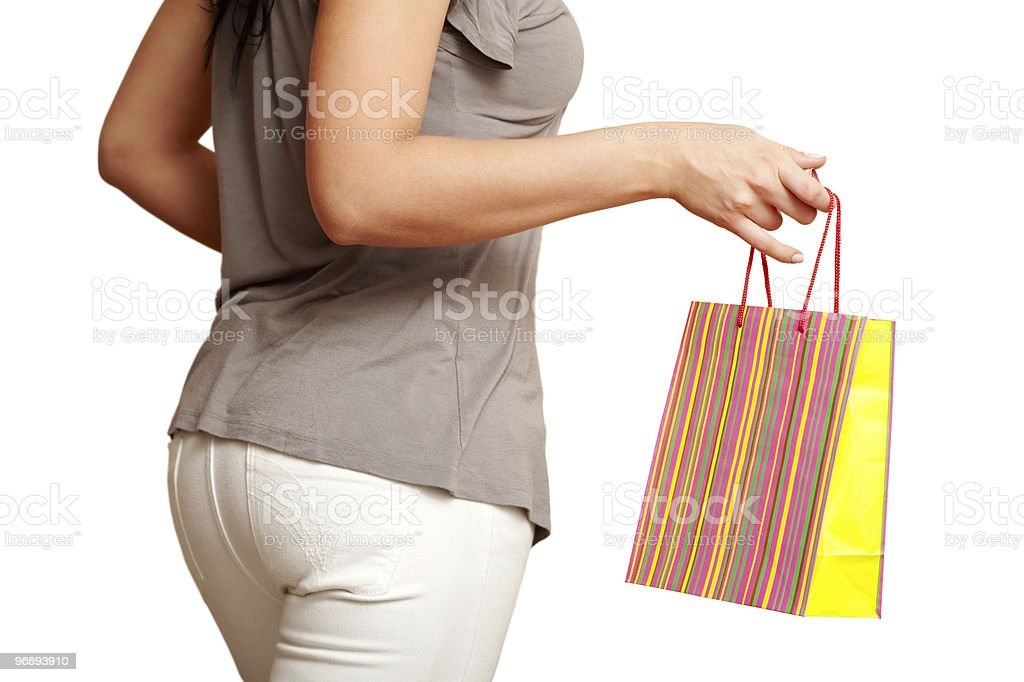 Shopping bag in girl's hand royalty-free stock photo