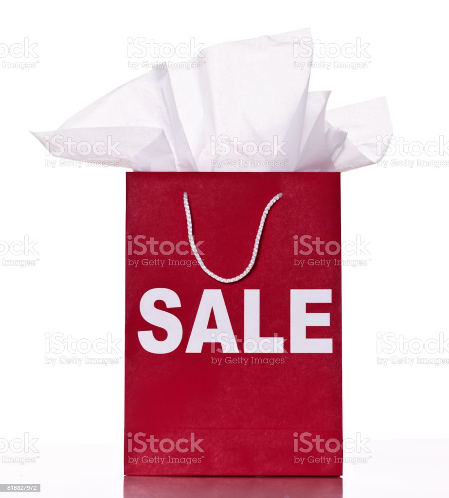 Shopping bag stuffed with tissue paper is labelled SALE stock photo