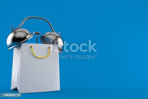 istock Shopping bag with alarm clock 1060655720