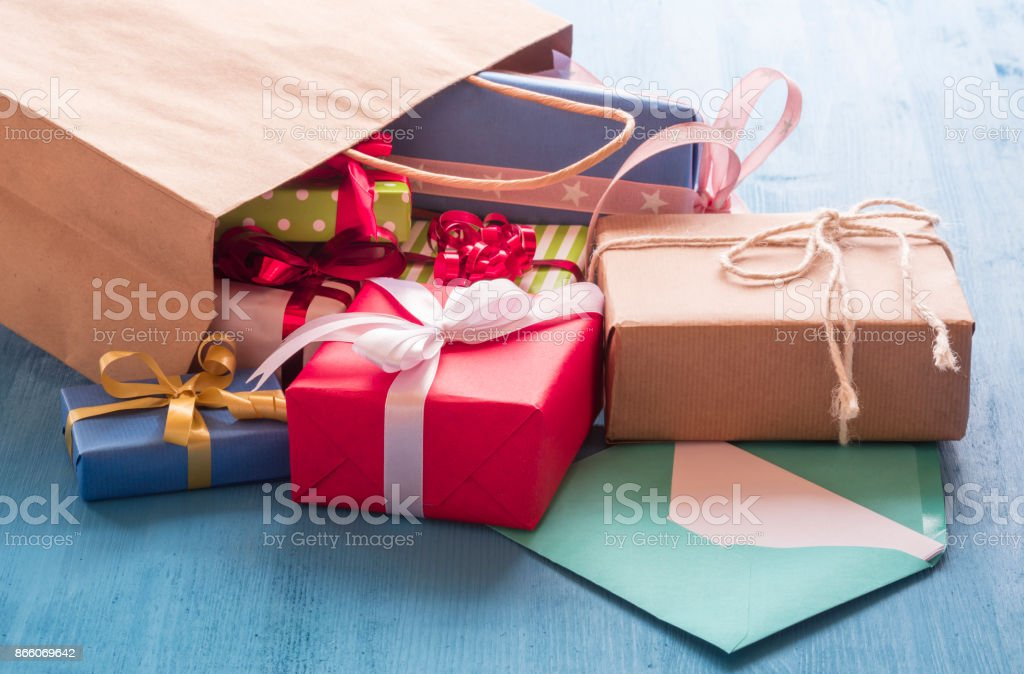 Shopping bag with gift boxes stock photo