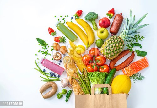 istock Shopping bag with groceries full of fresh vegetables and fruits 1131795548
