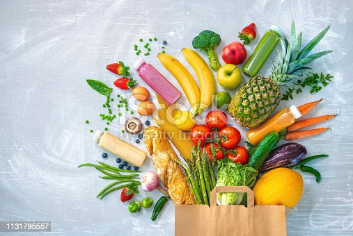 istock Shopping bag with groceries full of fresh vegetables and fruits 1131795557
