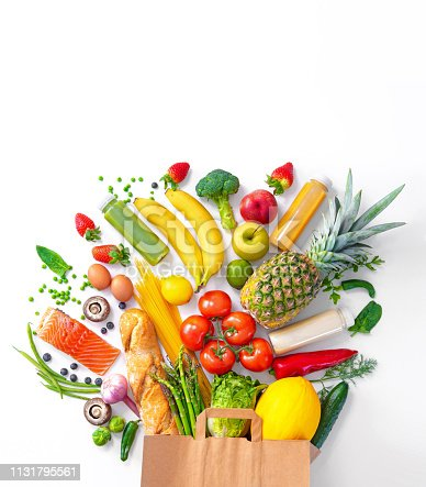 istock Shopping bag with groceries full of fresh vegetables and fruits 1131795561
