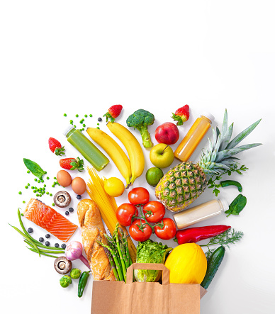 Healthy food selection. Shopping bag with groceries full of fresh vegetables and fruits