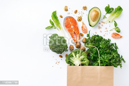 1126188273 istock photo Shopping bag with healthy food on white background with copy space top view 1183967795
