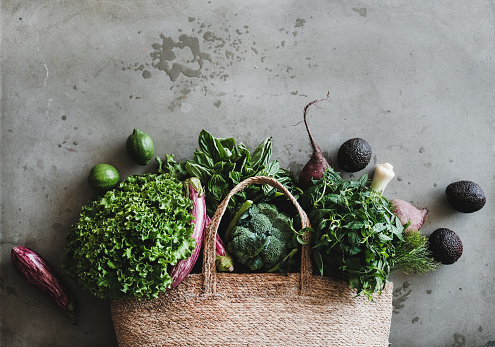 Shopping bag with healthy fresh vegetables and greens from market
