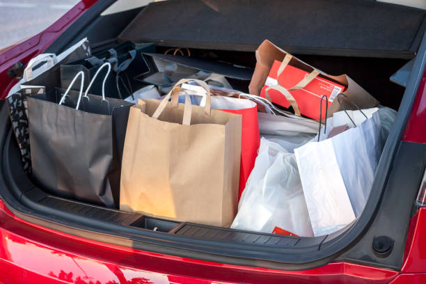 shopping bags in car many shop bags in car trunk shopping concept full stock pictures, royalty-free photos & images
