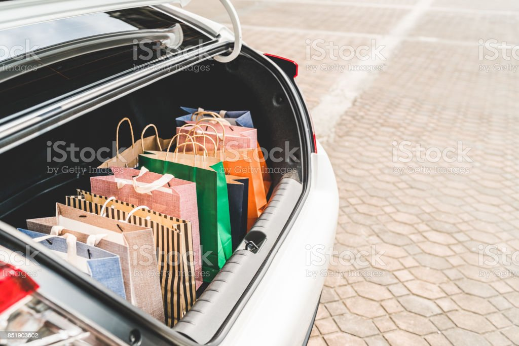 Shopping bags in car trunk with copy space. Modern shopping lifestyle, rish people or leisure activity concept stock photo