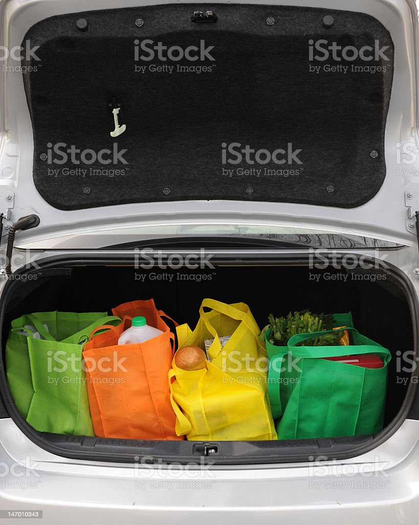 Shopping bags in the boot of a car stock photo