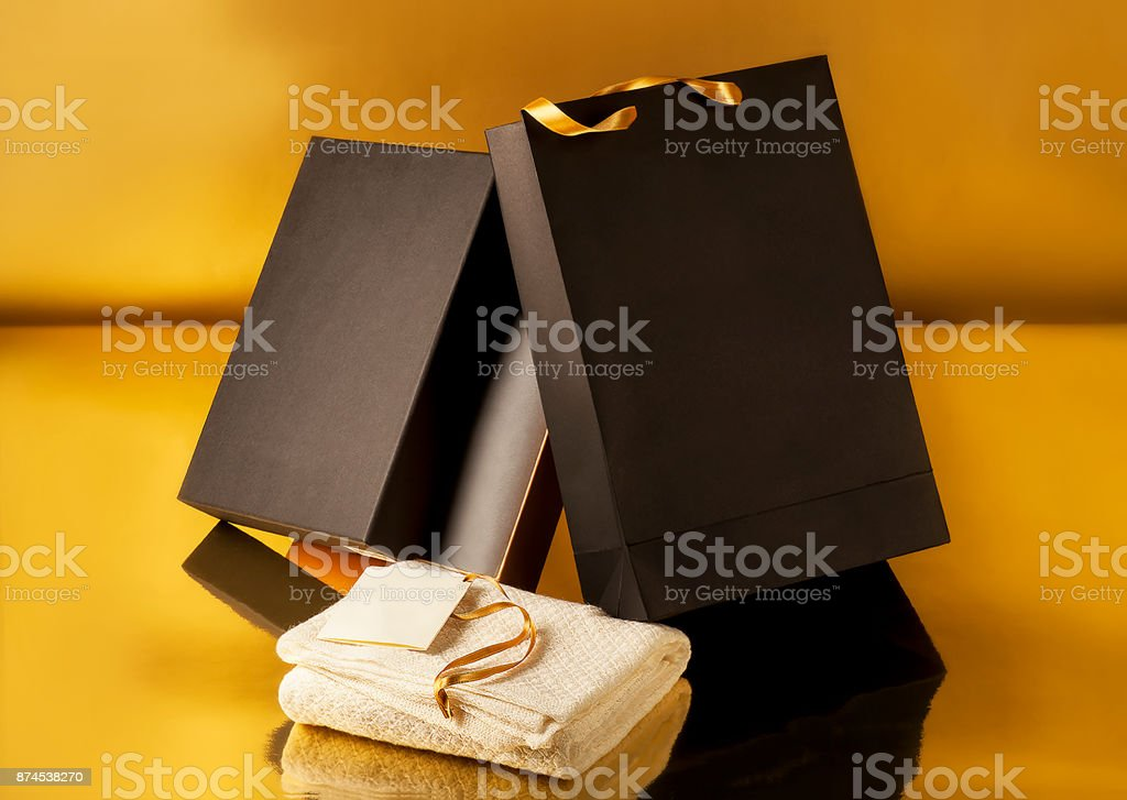 Shopping bags on yellow backgrund stock photo