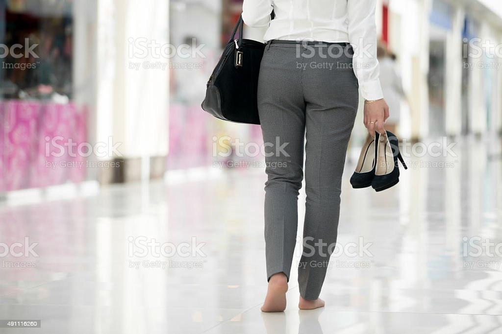 Shopping barefoot stock photo