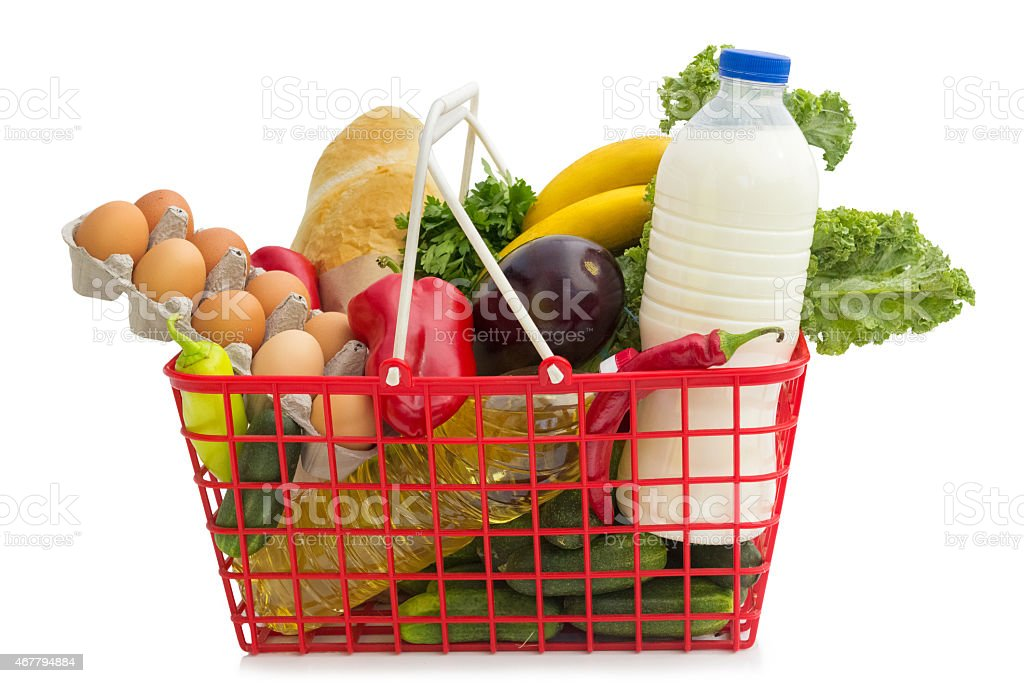 Shopping basket filled with healthy vibrant foods  stock photo