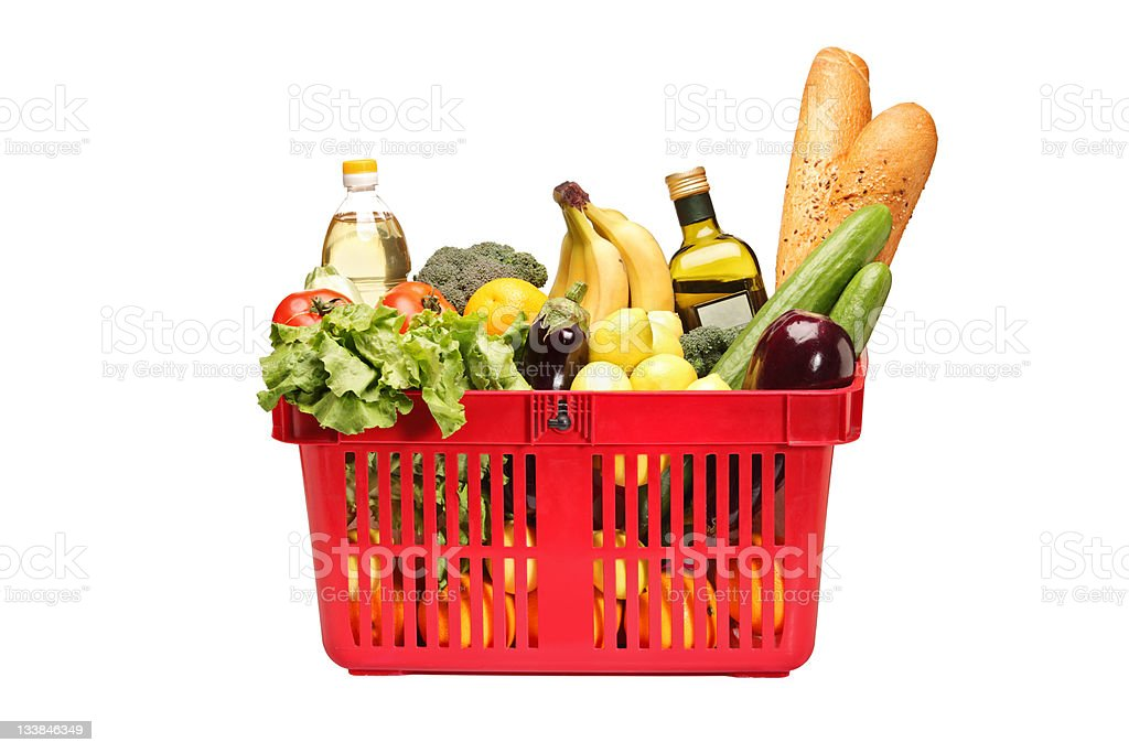 Shopping basket full with groceries stock photo