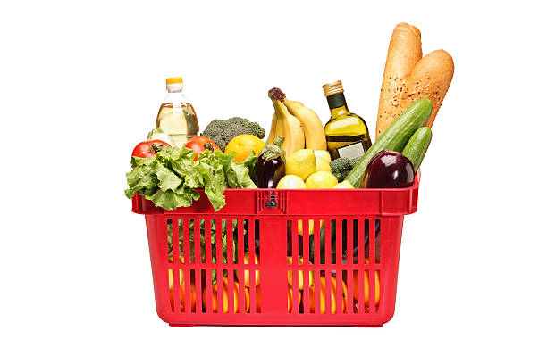Shopping basket full with groceries A studio shot of a shopping basket full with groceries isolated on white background shopping basket stock pictures, royalty-free photos & images
