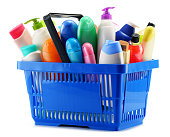 Shopping basket with body care and beauty products over white