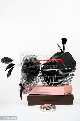 455111881 istock photo shopping basket with female hat with veil in retro style and bag with make up on gift boxes white background. Black Friday Thanksgiving Christmas shopping sale concept. Vintage, copy space 1044642526