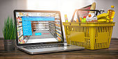 istock Shopping basket with food and laptop with interface of payment online on the screen. Online ordering and delivery food concept. 1247061315