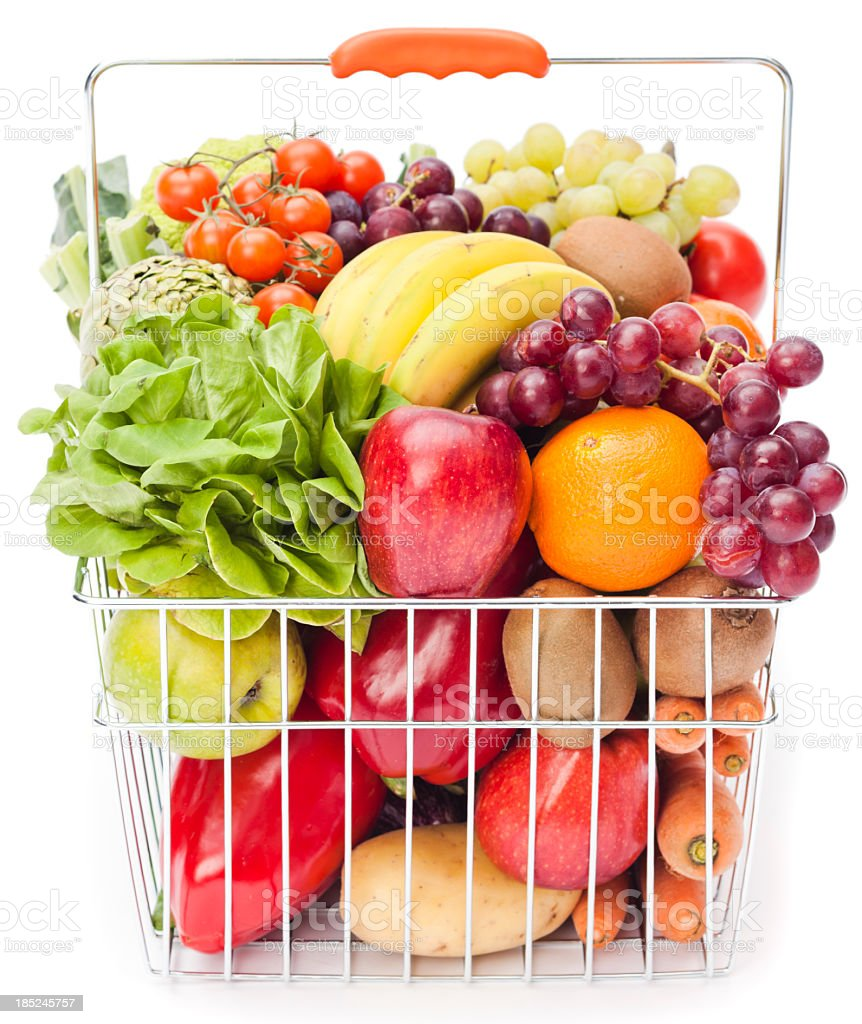 Shopping basket with fruits and vegetables stock photo