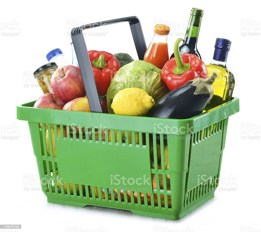 Shopping basket with groceries on a white background stock photo