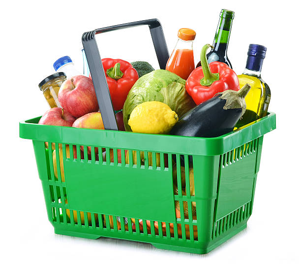 Shopping basket with groceries on a white background Shopping basket with groceries isolated on white background shopping basket stock pictures, royalty-free photos & images