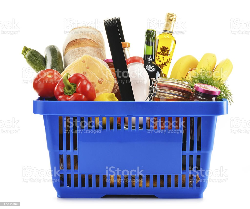 Shopping basket with variety of grocery products isolated on white stock photo
