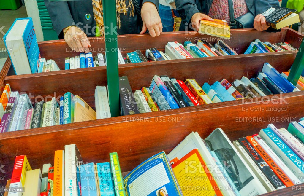 shopping books in outdoor bookstore stock photo