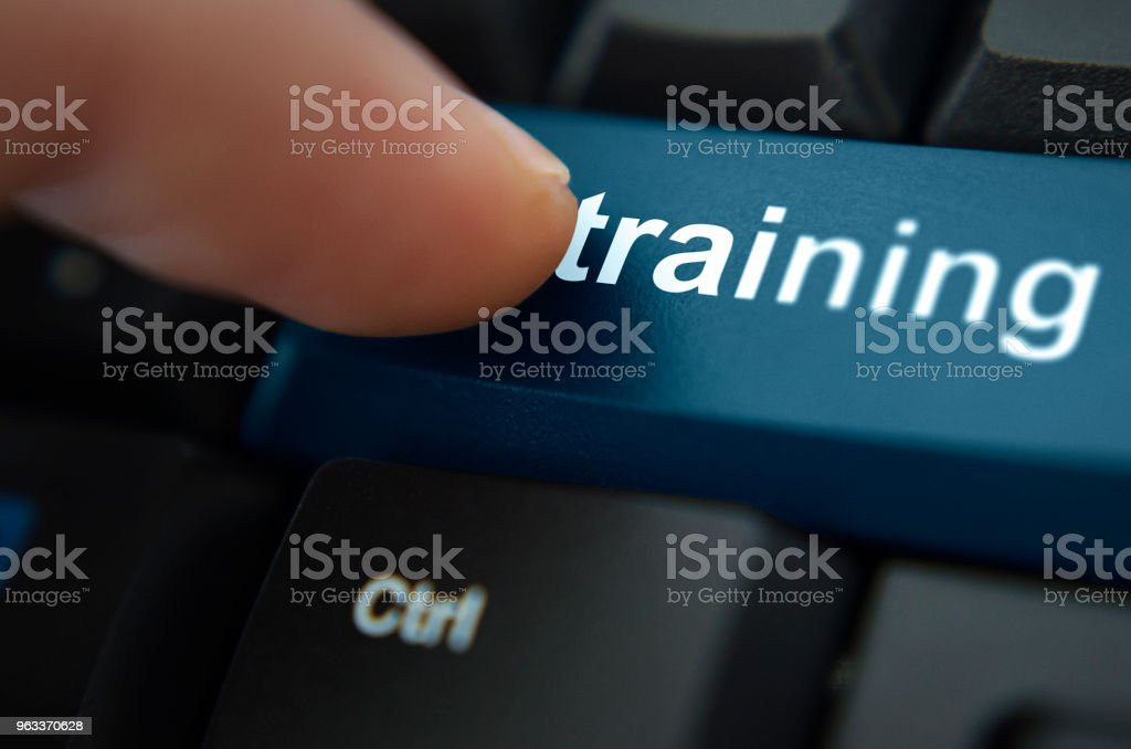 Shopping buttonKeyboard with training button highlighted stock photo