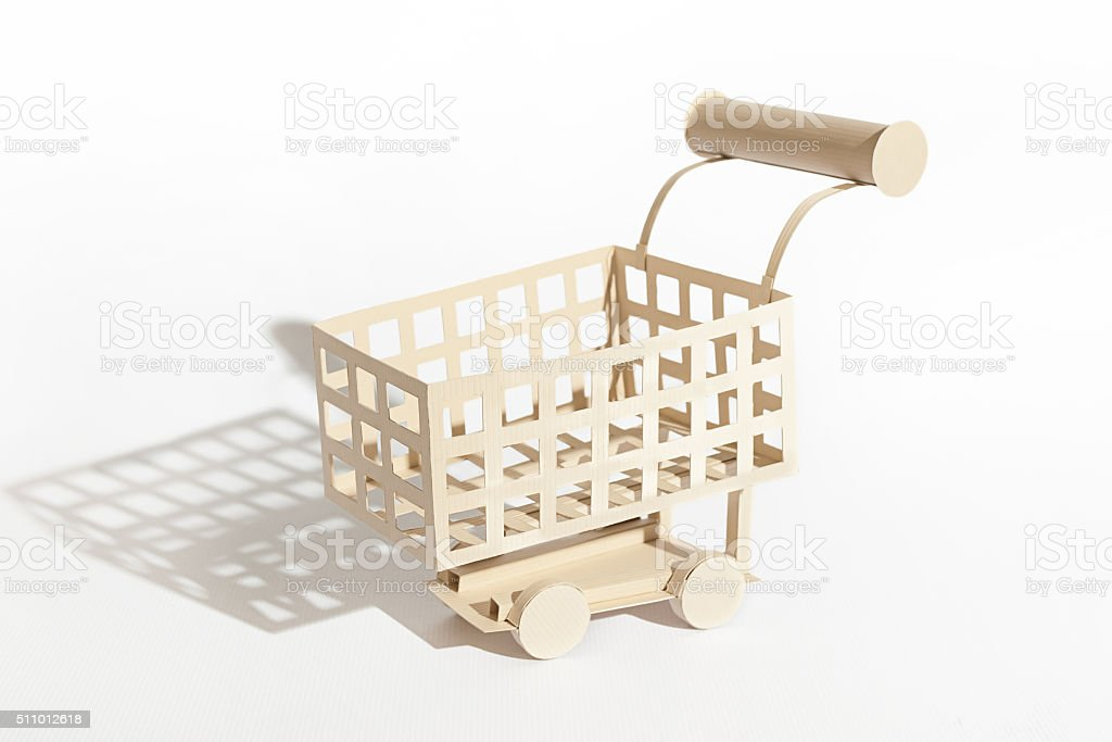 Shopping cart cut out of paper stock photo