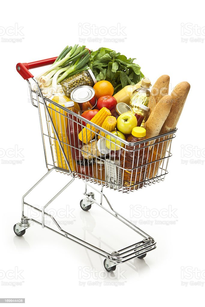 Shopping cart filled with all sort of groceries and food stock photo