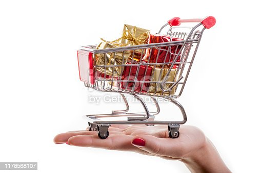 Shopping cart filled with presents isolated on white background. Christmas, birthday and sale concept.