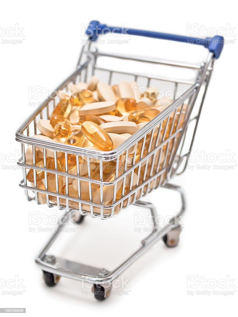Shopping cart filled with vitamin tablets royalty-free stock photo