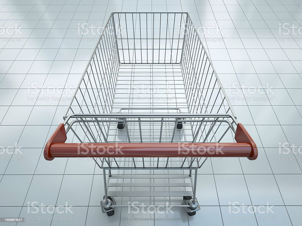 Shopping cart from behind in a supermarket stock photo