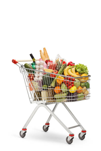 Shopping cart full of food products Shopping cart full of food products isolated on white background cart stock pictures, royalty-free photos & images