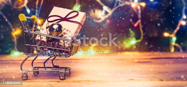Shopping cart full of presents. Christmas gifts shopping. Online shopping, Black Friday and Cyber Monday concepts. Trolley cart with gifts. Copy space