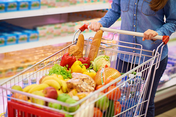 shopping cart full of products - full stock photos and pictures